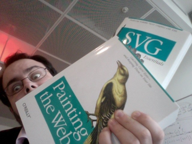 "David is holding copies of ""SVG Essentials"" and ""Painting the web"""